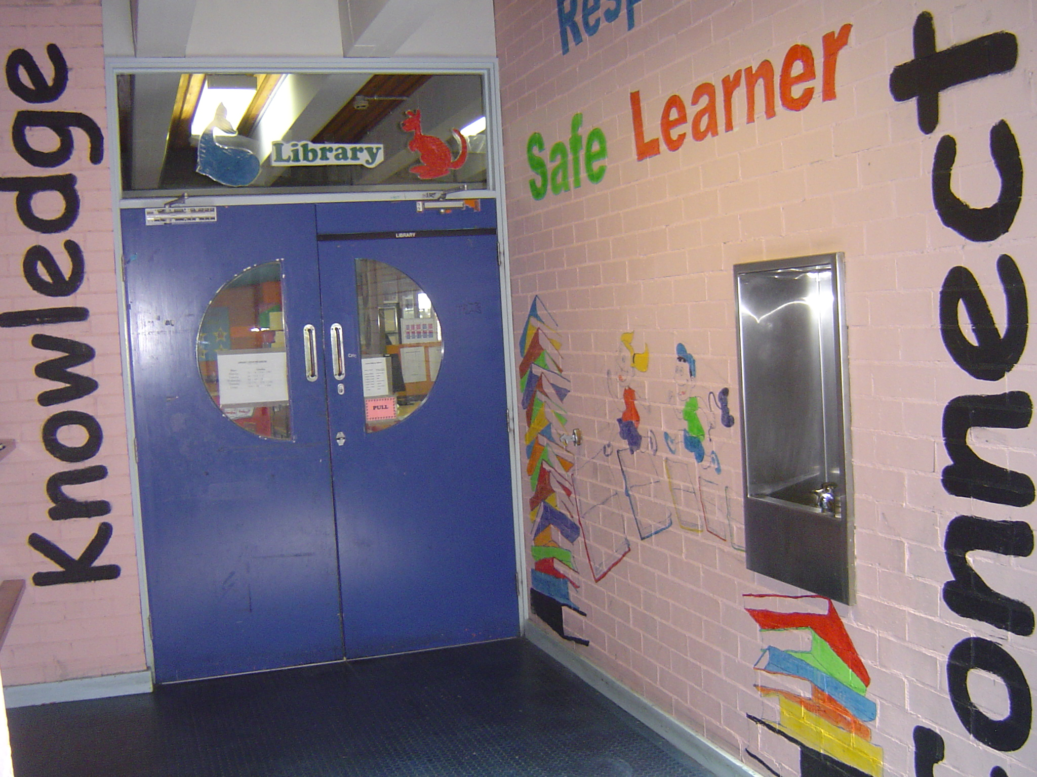 Welcome to Junior library which has a blue door entrance. Children love to rush in for stories and everyone can immerse themselves in a sea of knowledge.